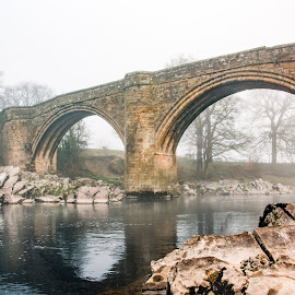 Bridge across the River Lunn by Darrell Evans - Buildings & Architecture Bridges & Suspended Structures ( yorkshire, old, crossing, trees, water, mist, stone, outdoor, dales, yorkshire dales, grass, kirby longsdale, lunn, bridge, river, fog )