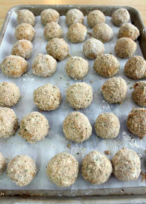Transfer the boudin balls to a greased baking sheet and refrigerate for at least...