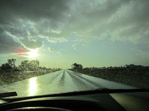 Photo: Enough rain to spot the windshield, but a welcome sight, nonetheless....
