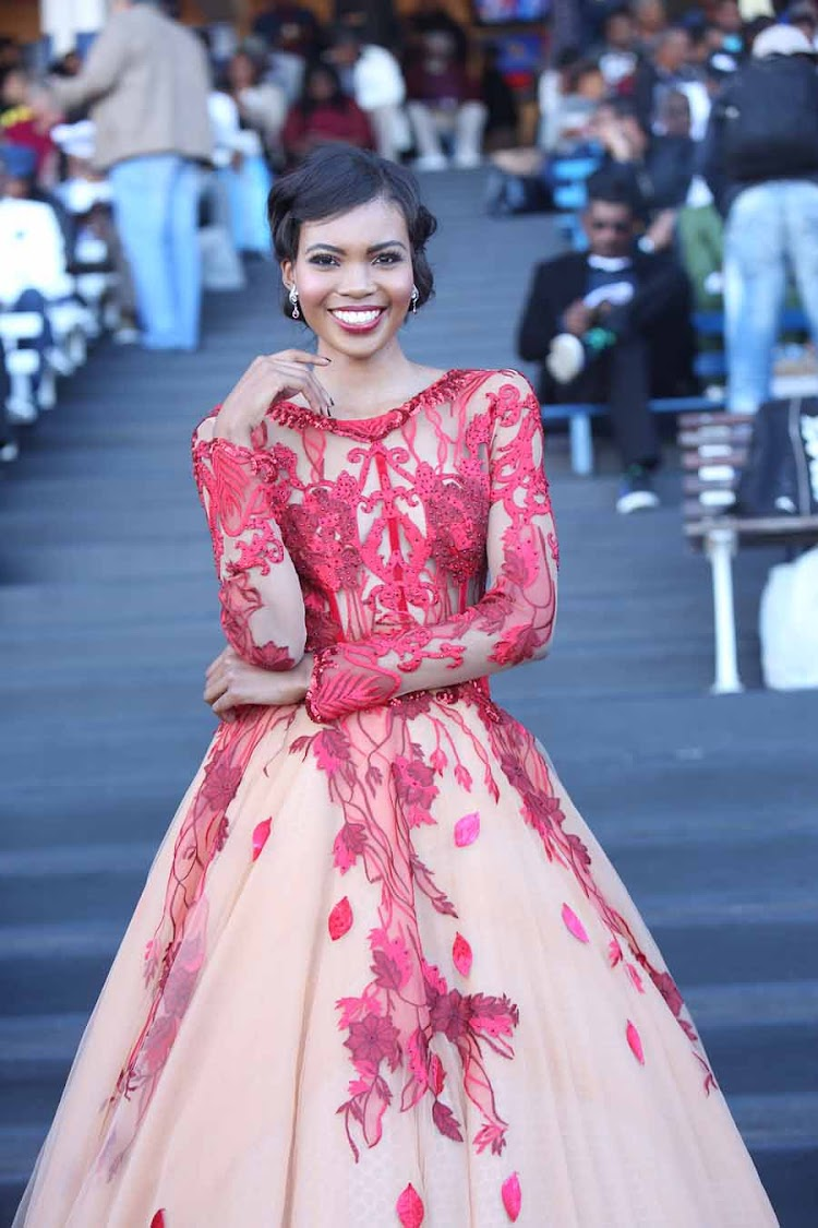 Miss SA World Thulisa Keyi was blushing in red at The Vodacom Durban July