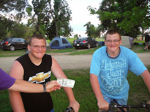 Photo: At our camp site, we often get visitors who help us out with cash donations, Bryon and Brandon Dykstra, giving us a $100 bill.