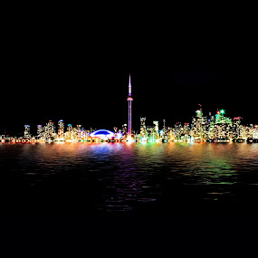 Toronto Skyline At Night From Centre Island Reflection by Brian Carson - City,  Street & Park  Skylines ( skyline, harbor, metropolis, brian carson, skyscrapers, location, bright, centre, toronto, metropolitan, vibrant, travel, cityscape, architecture, glow, historic, backdrop, city, buildings, dark, the learning curve photography, place, black, highrise, canada, colors, twilight, horizon, lake, destination, landmark, environment, outdoors, canadian, scene, view, www.thelearningcurve.ca, famous, reflection, concept, colorful, landscape, panorama, lights, modern, towers, skyscraper, stylish, nighttime, cn tower, evening, downtown, tall, water, abstract, building, metro, night time, ontario, scenic, urban, tower, color, background, artistic, night, glowing,  )