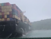 A screenshot of a container-laden ship that had been blown into the Durban harbour's mouth, blocking it.