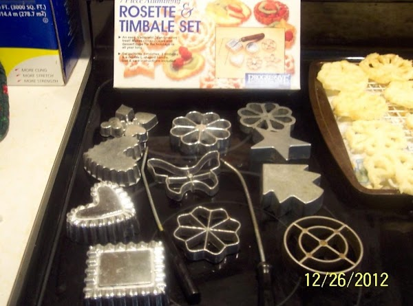 Gather the rosette irons,you want to use.Combine eggs, sugar, and salt, beat well.Add remaining...