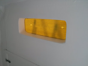 Photo: Marking the area of the opening on the inside while the window is clamped in position.