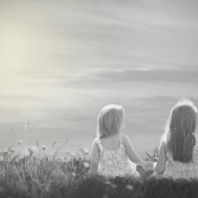Sister Love by Shayne Janks Nicolas - Babies & Children Child Portraits ( field, love, skye, little girl, sisters, black and white, sunset, children, siblings, flowers, holding hands )