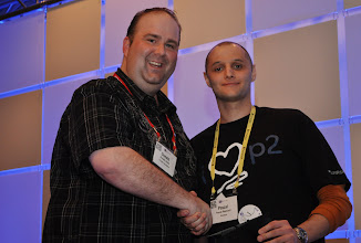 Photo: Donald Smith and Pascal Rapicault at EclipseCon 2011.  Everybody loves p2.