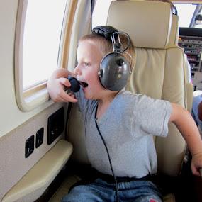 First airplane ride by Cathleen Steele - Babies & Children Children Candids ( amazed, surprise, enjoyment, joy, experience, boy, fun )