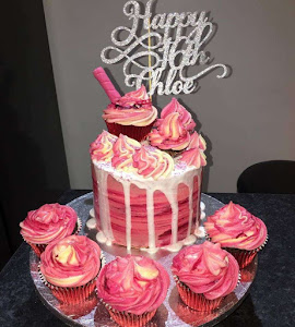 Pink drip cake with matching cupcakes