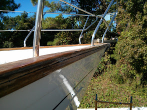 Photo: cleaning up the failed cap rail seam at the starboard bow.
