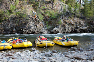 Photo: Man tying on fly while rafting the Middle Fork of the Salmon River, ID.