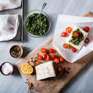 Baked Fish Packets with Pesto & Tomatoes.