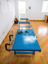 Photo: the workbench, with clamps, a hand plane, chisel and hammer