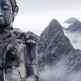 Buddha statue on snow peak by Vyacheslav Beluha - Buildings & Architecture Statues & Monuments ( close to heaven., world wonder, buddha, snow peak, below heaven, hiking, winter, pray, religion, cold landscape,  )