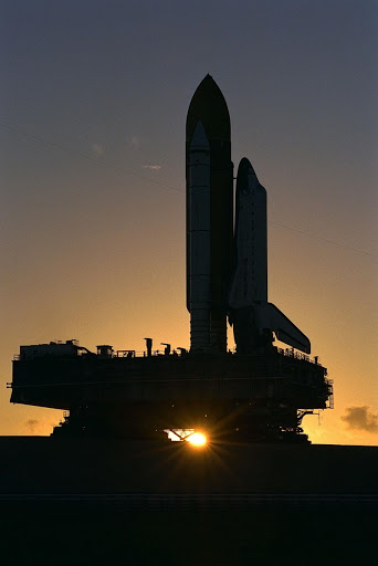 The Space Shuttle orbiter Atlantis rolls out to Launch Complex 39A in preparation for mission STS-86 which is targeted for a September launch.