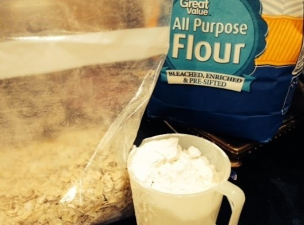 For the topping, add the oatmeal, flour and sugar into a large zip lock...