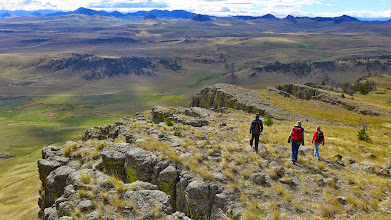 Photo: Heading to the south side of the butte - The linear ridge on the prairie is an igneous dike.