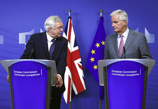 UK Brexit Secretary David Davis, left, and the European Commission's chief brexit negotiator, Michel Barnier, talk to reporters at the start of a first full round of talks on the terms of Britain's divorce from the European Union, in Brussels, Belgium, on July 17 2017. Picture: REUTERS