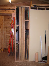"""Photo: The left side is divided to store 4 of my folding """"StoreHorse"""" sawhorses (top & bottom) and the Ridgid outfeed tables in the middle..."""