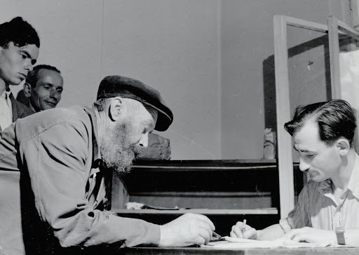 Jewish survivors registering at the employment service of the Central Committee of the Jews in Poland