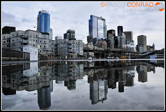 Photo: © Paul Conrad/Pablo Conrad Photography The skyline of Seattle, Wash., is reflected in a rain puddle on Pier 63 along the waterfront on Tuesday Feb. 15, 2011.