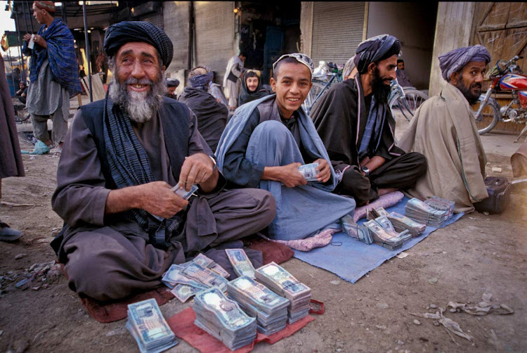 A street money exchange in Afghanistan. Are these guys on the level? No idea!