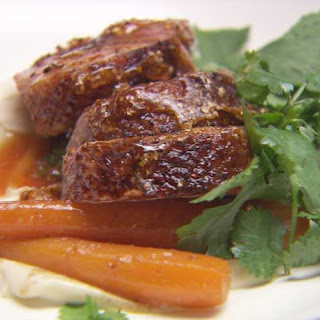 Duck with Coriander Praline and Grand Marnier Sauce with Cardamom Cauliflower Puree and Glazed Carrots.