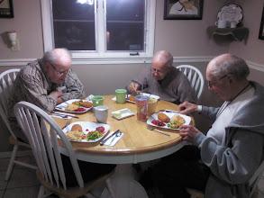 Photo: Three vets having Supper