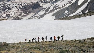 Photo: A group of people peaking Mt. Rainier.