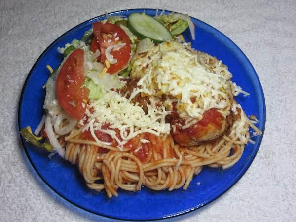 Chicken Mozzarella With Spaghetti And Salad On A Blue Plate.