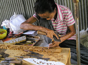 Photo: Sankamphaeng woman wood carving.