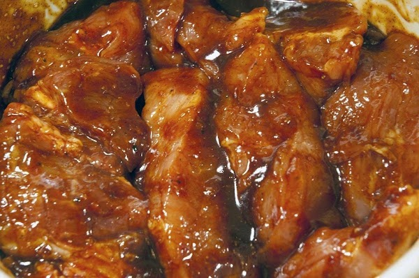 Add the pork to the bowl, and combine with the marinade.