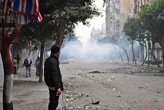 Photo: A youth stands in front of a haze of recently fired tear gas by Mohamad Mahmoud St.