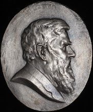 Photo: Small silvered copper medallion of Alfred Russel Wallace by Albert Bruce-Joy (1842-1924), modeled from photographs and from life. Copyright: G. W. Beccaloni.