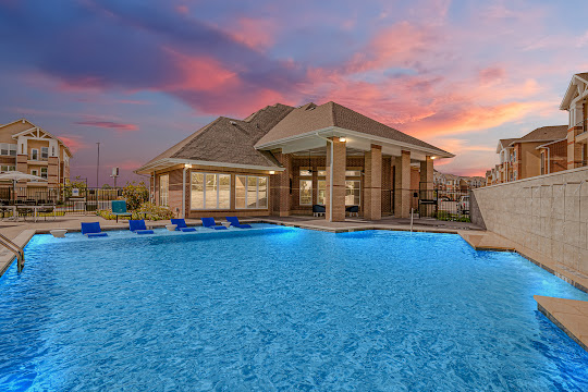 Swimming pool with view of clubhouse at Winding Creek at The Preserve