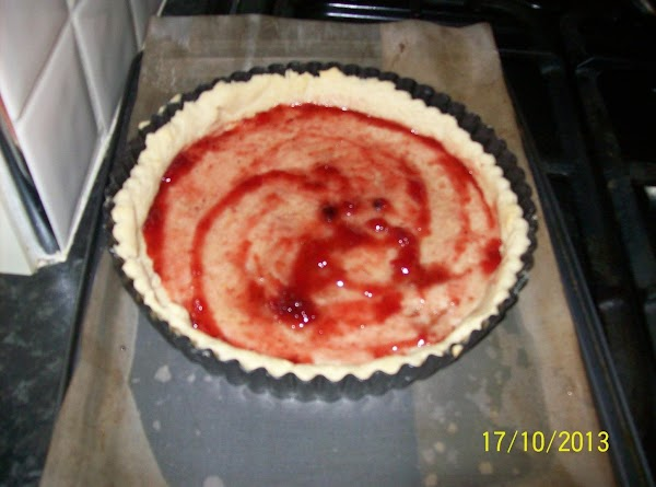 Spread the raspberry jam on the  inside of the pastry case ,then set...