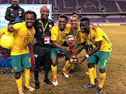 Percy Tau, assistant coach Thabo Senong, Lebogang Mothiba, Ryan Moon and Innocent Maela  celebrate their win over Zambia at the  four nations tournament in Ndola.