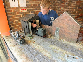 "Photo: 022 Here is Paul & Steph Hickling's un-named assistant working hard again. The photo clearly illustrates how large the models are when built to 7/8"" to the foot (1:13.5 scale). Track gauge is 45mm (1¾"") ."