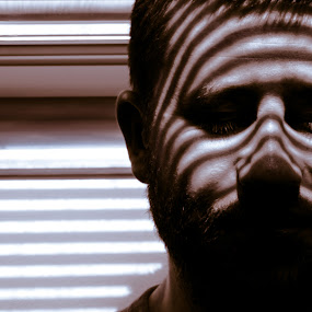 Lines on face by Lidia Steffy - People Portraits of Men ( face, tiger, silence, mood, lines, men, portrait, shadows, eyes )