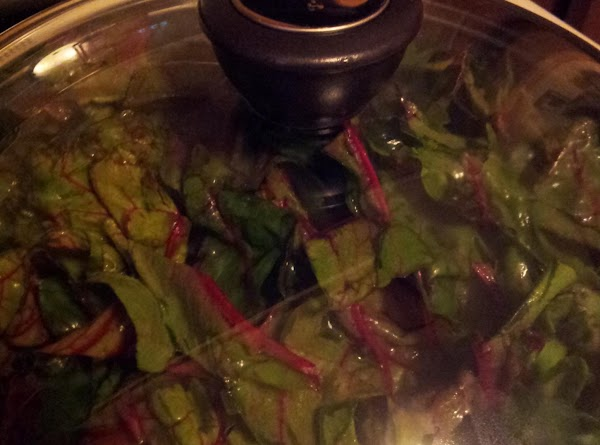 Remove leaves from bowl (do not drain). Add to saute pan and cover. Cook...