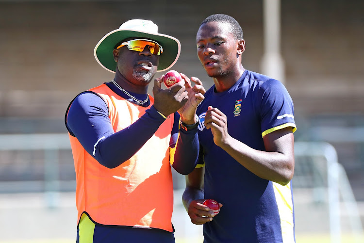 South Africa head coach Ottis Gibson (L) in a discussion with fast bowler Kagiso Rabada (R) during the Sunfoil Test Series training session at Newlands Cricket Ground, Cape Town on 2 January 2018.