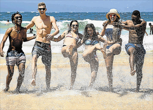 KICKING BACK: Hlumelo Swartz, McGregor Jackson, Jamie Sjouerman, Brittany Dove, Lara Longworth and Zano Pupuma splash in the water at Central Beach, Plett, at last year's Rage Picture: EWALD STANDER
