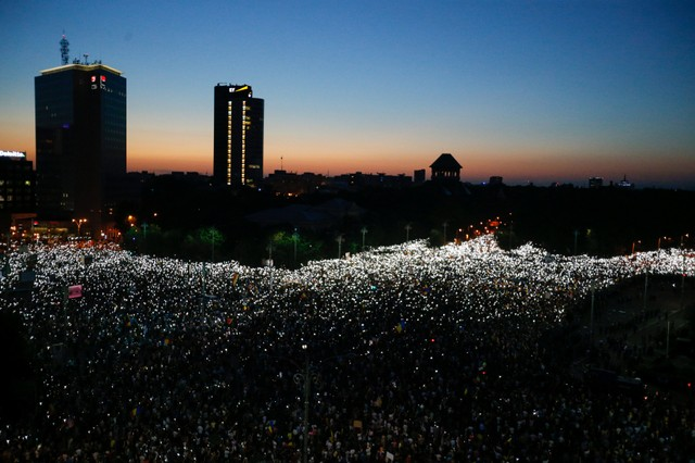 Protesters gather during a demonstration in Bucharest, Romania, August 10, 2018.