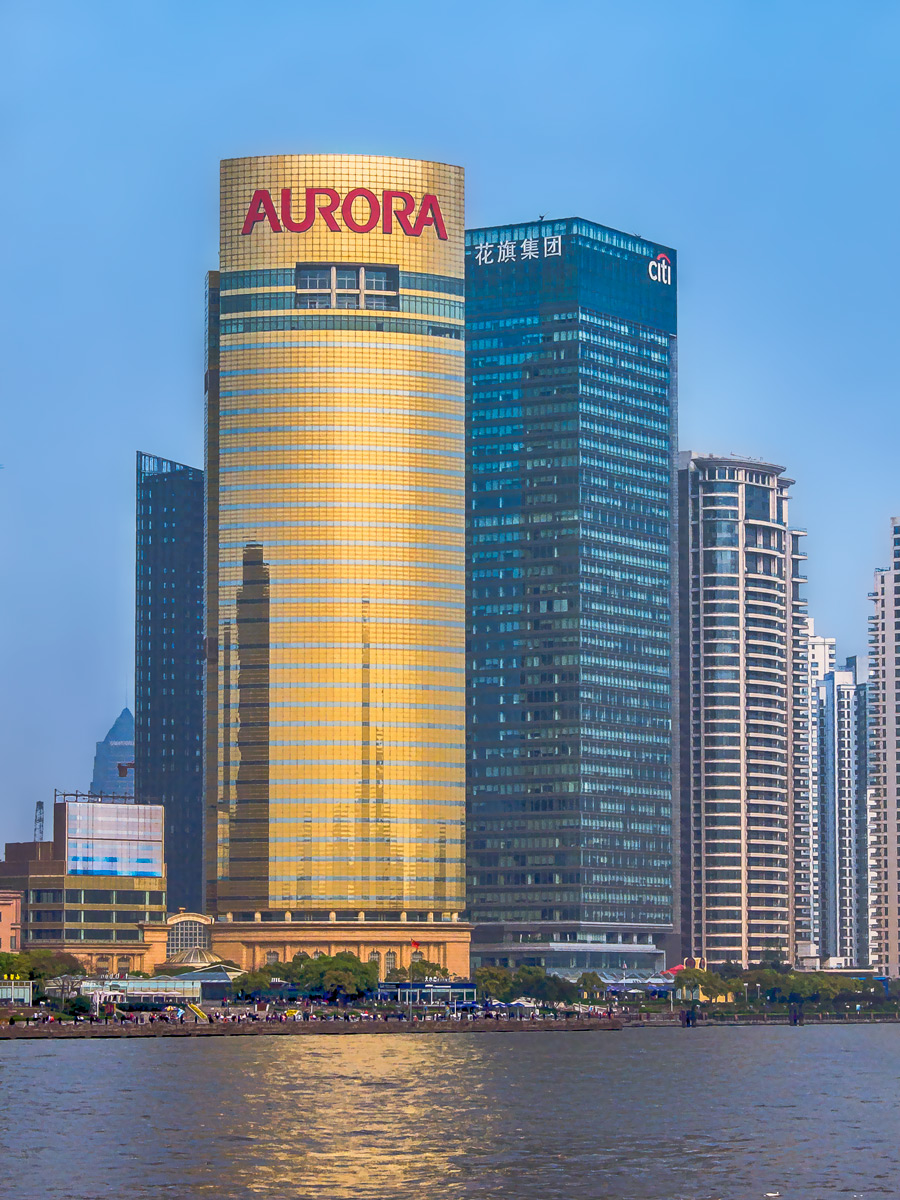 Photo: Aurora AU being the symbol for gold, this building seems to carry a message.  This is looking across from The Bund in Shanghai, China. All I can say is, thank goodness for Photoshop and the various plugins available to drag this out of the original material. You know, as much as I love post processing, there are days when I wish I was a better photographer and didn't have to work so hard on these things!  #Travel   #China   #Shanghai