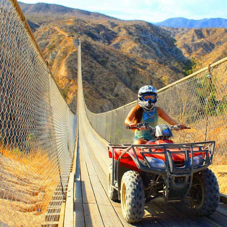 Here I am crossing the suspension bridge on my ATV. It was a rush!