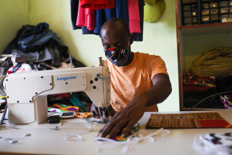 A worker sews face masks in Joburg. SMMEs such as these have been hard hit by Covid-19, and need support to survive. Picture: Alaister Russell/SUNDAY TIMES