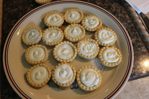 Spoon 1 to 1-1/4 teaspoons goat cheese into each tart shell.