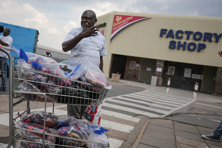 Businessman Phillip Sibia returns meat to the Enterprise factory store in Germiston.