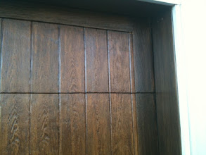 Photo: Cedar Park Overhead Doors Demo Door number 2  with multiple finishes. A Lighter field with a darker perimeter. Available for viewing at 2507 S Bell Blvd. Cedar Park TX 78613. 512-335-7441