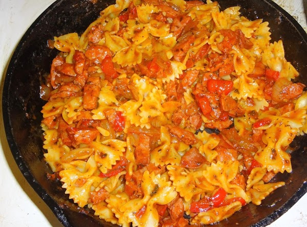 Cook 2 cups bow tie pasta, while that is cooking dice up the kielbasa,...